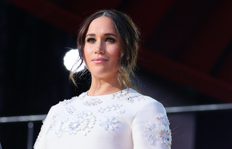 Meghan Markle in a white dress on stage