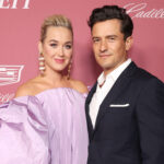 Katy Perry in a purple dress with Orlando Bloom in a black suit