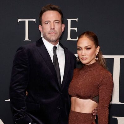 Ben Affleck in a black suit with Jennifer Lopez in a brown dress