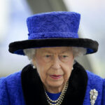 Queen Elizabeth in a blue outfit and hat