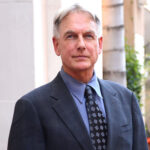 Mark Harmon smiling in a grey suit