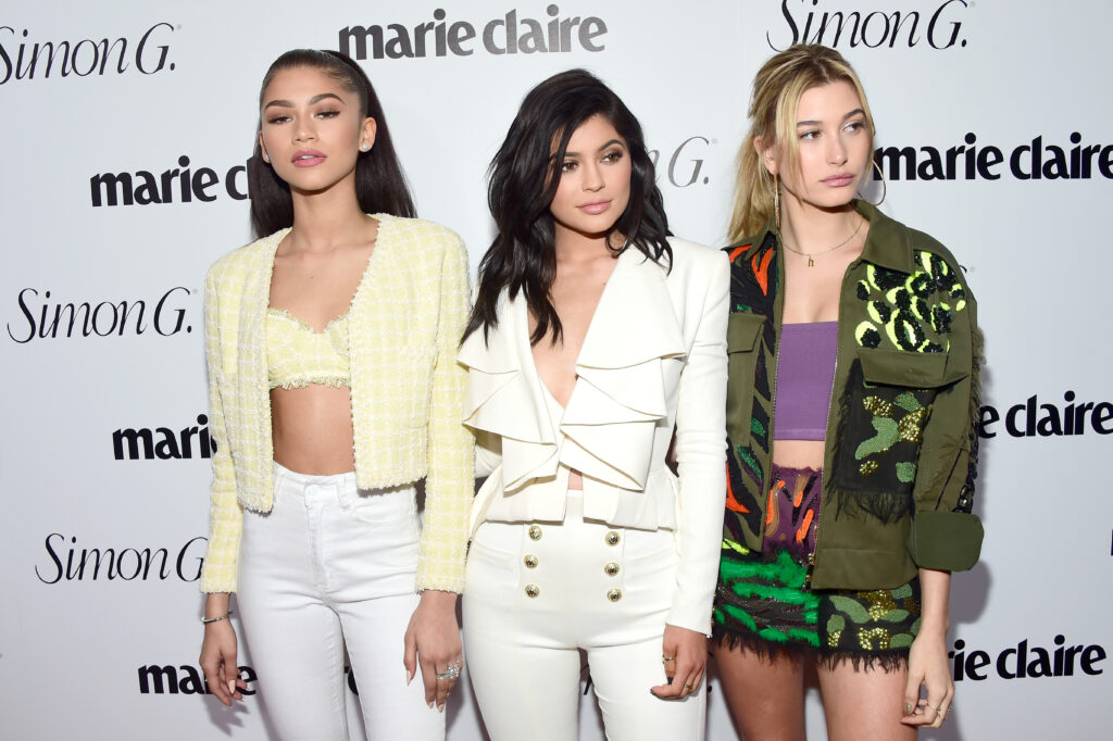 """LOS ANGELES, CALIFORNIA - APRIL 11: (L-R) Actor Zendaya, tv personality Kylie Jenner and model Hailey Baldwin attend the """"Fresh Faces"""" party, hosted by Marie Claire, celebrating the May issue cover stars on April 11, 2016 in Los Angeles, California."""