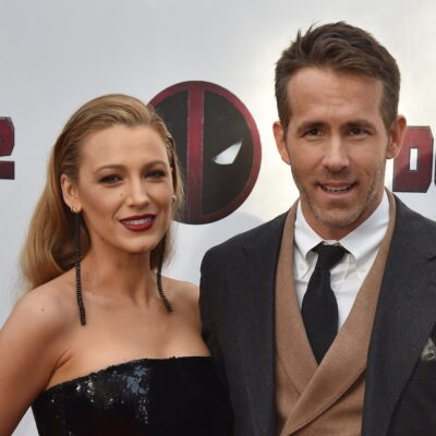 Blake Lively in a black dress with Ryan Reynolds in a grey suit