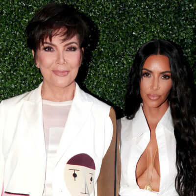 Kris Jenner in a white outfit with Kim Kardashian in a white outfit