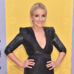 Jamie Lynn Spears with her hands on her hips, wearing a black dress