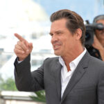 Josh Brolin smiling and pointing to someone off camera.