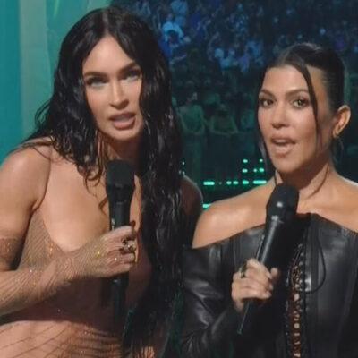 Screenshot of Megan Fox on the left, Kourtney Kardashian on the right, presenting at the 2021 VMAs on MTV