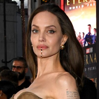 Angelina Jolie wears a brown, strapless dress on the Eternals red carpet