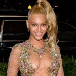 Beyonce wears a sheer gown with colorful jewel accents to the Met Gala