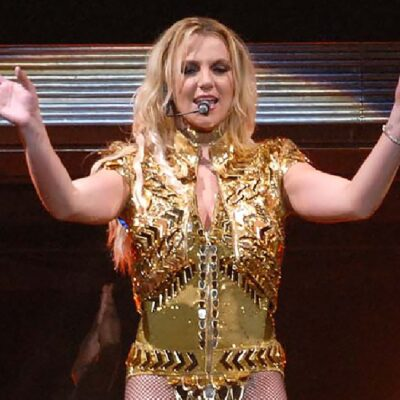 Britney Spears wears a golden costume on stage