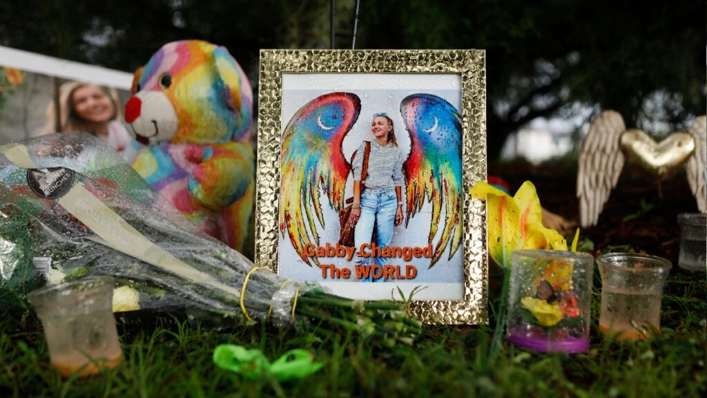 A memorial for Gabby Petito sits on the grass