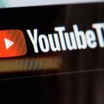 A photo of the YouTubeTV logo on a screen