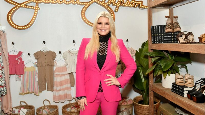 Jessica Simpson wears a pink suit in a store