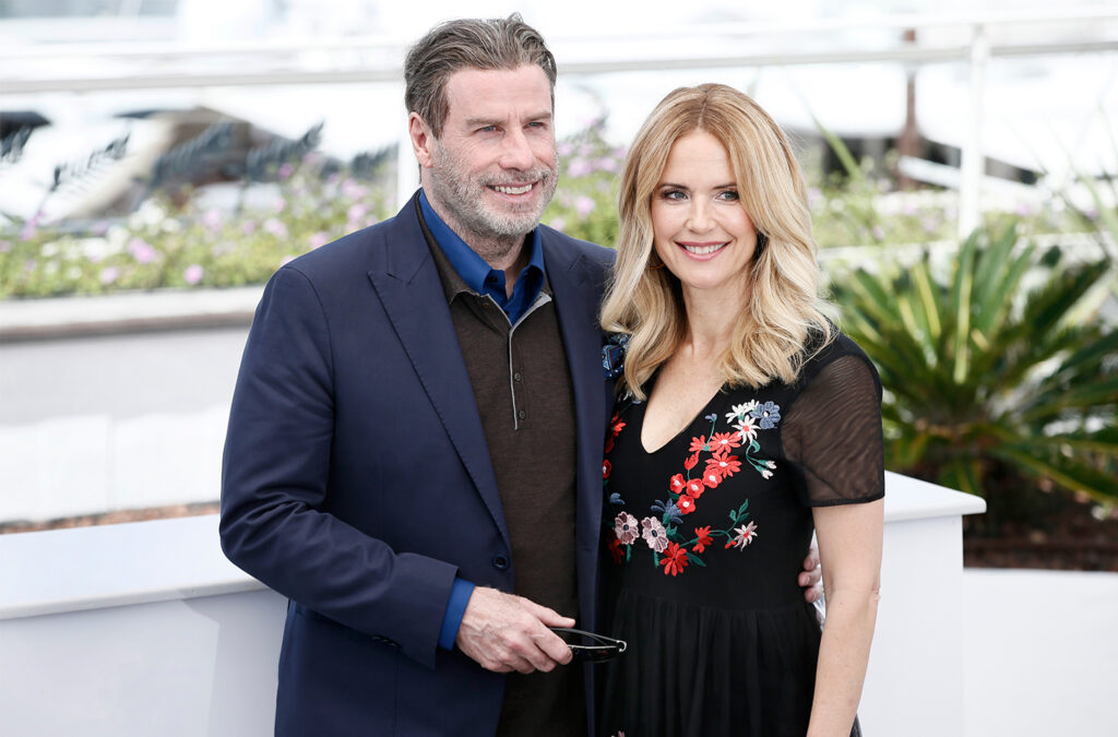 John Travolta on the left, Kelly Preston on the right, together at Cannes Film Festival