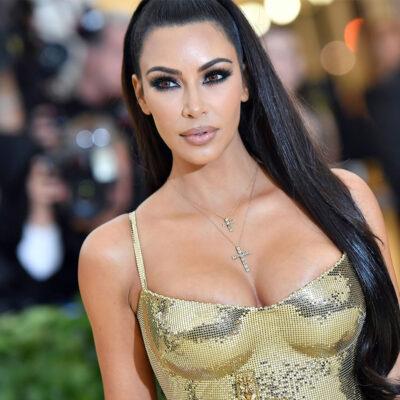 Kim Kardashian at the 2018 Met Gala in a gold dress.