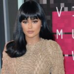 Kylie Jenner wears a black wig and a tan dress on the red carpet