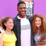 Michael Strahan poses with daughters Isabella and Sophie on the red carpet