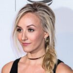 Nastia Liukin wears a black top and red bottoms on the red carpet