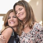 Natalie Morales, in a dark dress, receives a hug from Savannah Guthrie on the set of Today