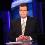 Neil Cavuto wears a dark suit during a TV interview