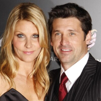 Jillian Fink and Patrick Dempsey, both dressed in black, pose on the red carpet