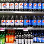 Bottles of PepsiCo sodas sit on a grocery store shelf