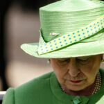Queen Elizabeth wears a green hat and dress to a royal event