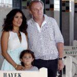 Salma Hayek poses alongside husband Francois-Henri Pinault and daughter Valentina outdoors