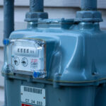 Residential natural gas meter measuring natural gas consumption.