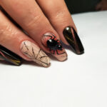 Image of coffin shaped nails with halloween designs