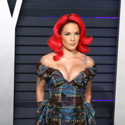 Halsey with bright red hair at a red carpet event in 2019.