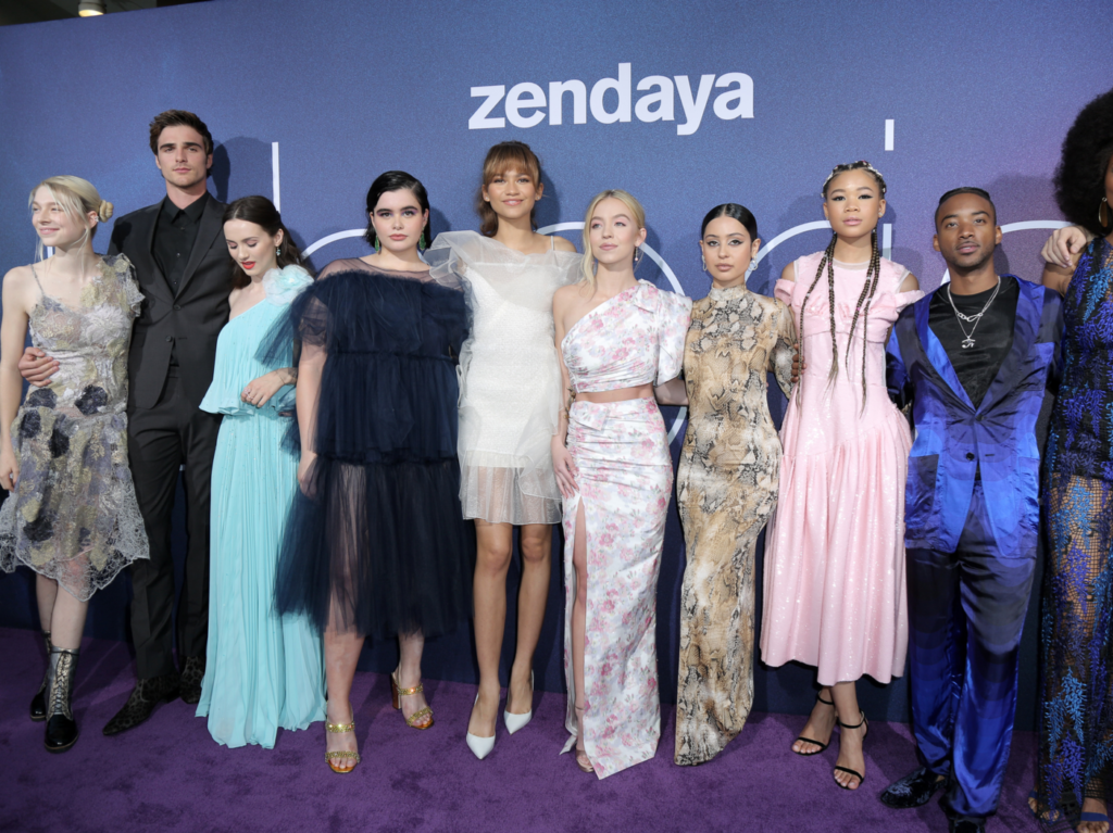 Zendaya stands with the cast of Euphoria on the red carpet