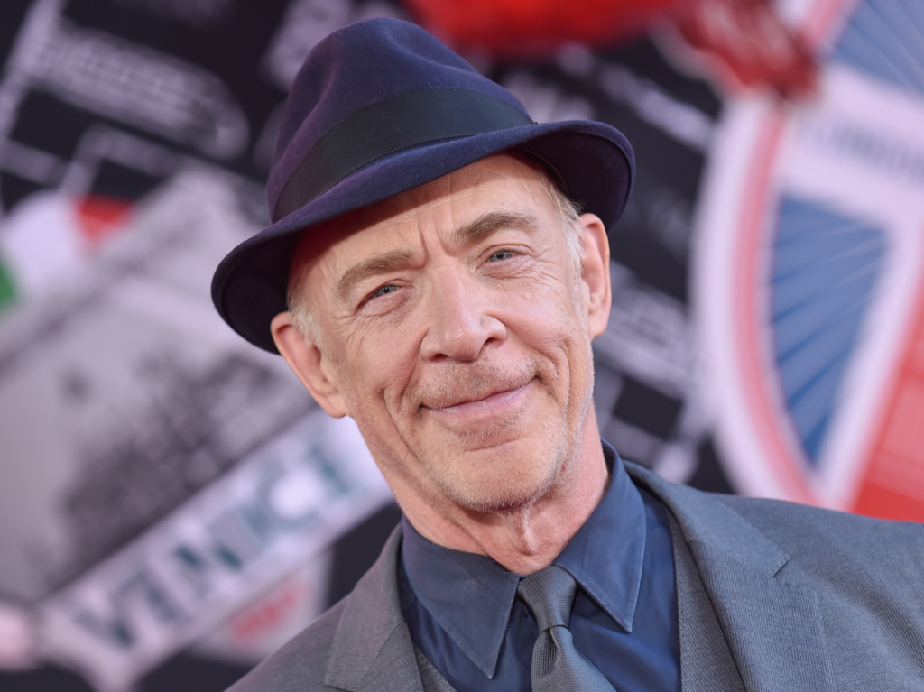 J.K. Simmons wearing a hat and suit