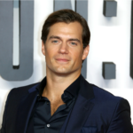 Henry Cavill looks dashing in a dark blue suit