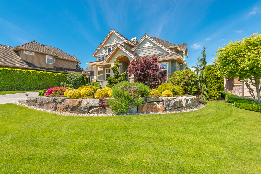 Home with a lot of landscaping.
