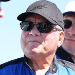 William Shatner wears a blue jumpsuit, black hat and sunglasses in Texas